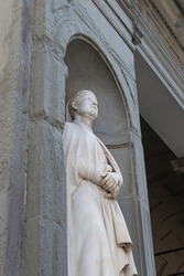 Building facade with typical statue of saint in Italy, Venice, Florence