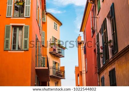 building facades with balconies ...