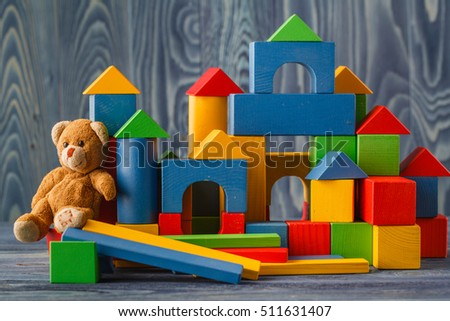 building from wooden colourful childrens blocks