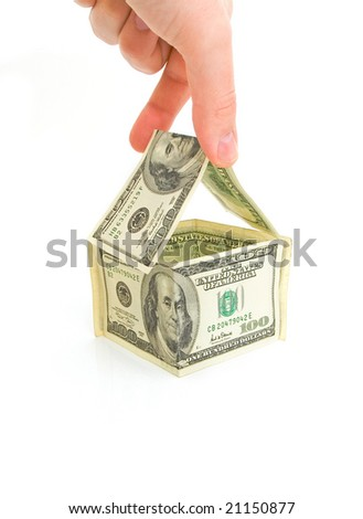 building house from 100 dollar bills isolated against white background