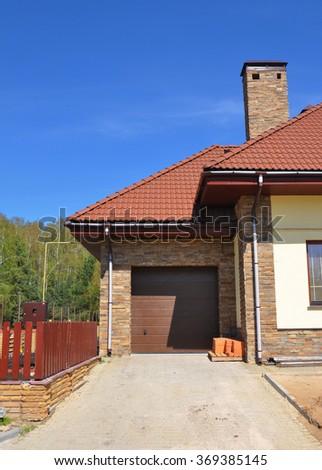 Building House Garage with New Garage Door