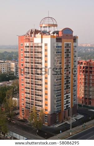 Building house in megapolis in evening time