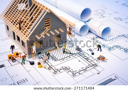 building house on blueprints...