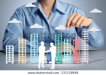 Building in a hand businessmen