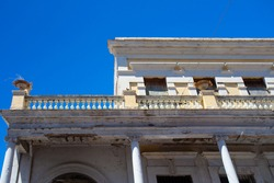 Building in disrepair with typical Caribbean architecture