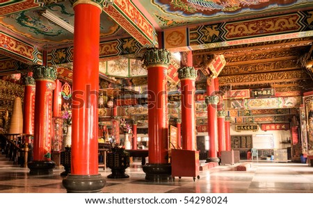 Building interior of colorful China temple with carving and inscription.
