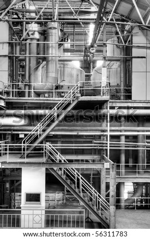 Building interior structure of old factory in black and white.
