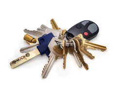Building manager key set or onsite caretaker. Multiple keys on key chain. Keys for: elevator, fire panel, service room, residential and commercial doors, pad lock, garage gate fob. Isolated on white.