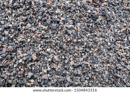 Building materials and fettling background, light crushed stone. Background texture of stone, crushed stone and brick