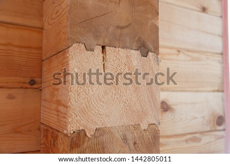 Building materials made of wood. Glued beams. Wooden beams in the groove. #1442805011