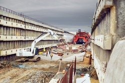 Building of new railway corridor with tunnel. Construction site with workers