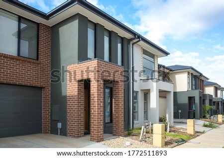 Building of some residential townhouses in a suburb of Australia. The exteriors of some two-story modern Australian suburban homes.