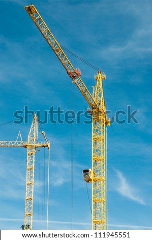 Building of the new high house by the crane - stock photo
