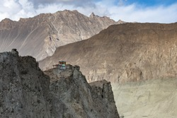 Building on the top of the rock in deserted mountains near Hopper glacier Hunza valley Pakistan Northern areas