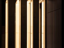 Building pillars and shining lights at night