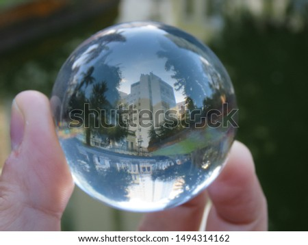 Building reflected backwards in a lake and with the glass ball, its reflection was perfect! #1494314162