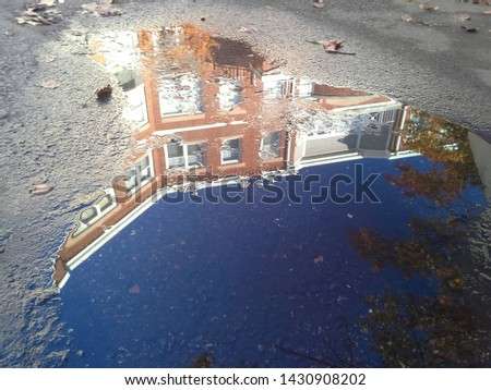 building reflected in a puddle #1430908202