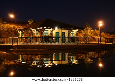 Building reflecting on water at River Walk Park in Bakersfield California