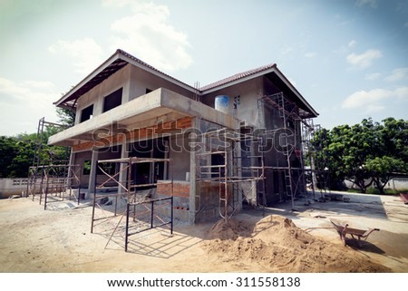 building residential construction house with scaffold steel for construction worker, image used vintage filter