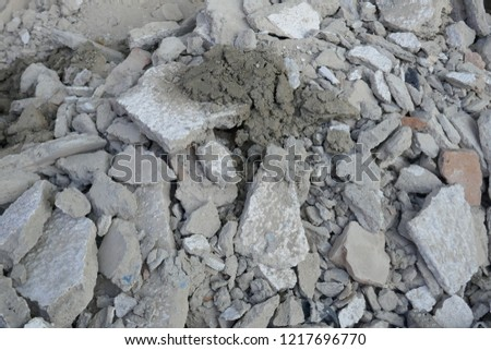 Building rubble, rubble pile with dust and stones