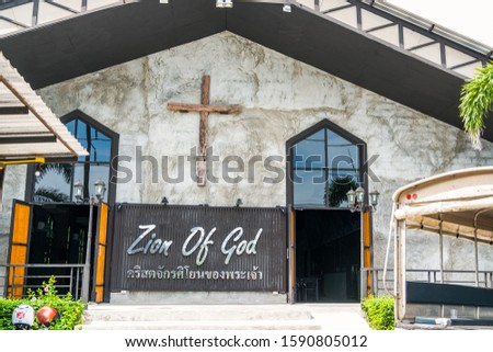Building's facade. On the facade of the cross - a symbol of religion