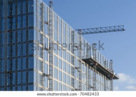 building site with blue sky and crane