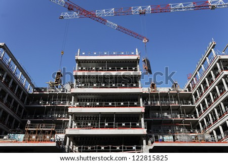 building site with crane in blue sky