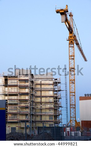 Building site with scaffolding and crane