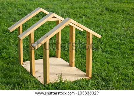 Building small dog house with lumber, frame completed