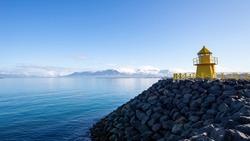 building stones coast sky on the sea