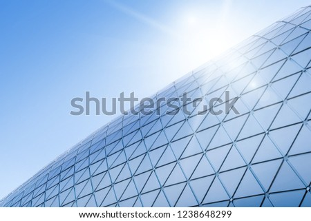 Building structures aluminum triangle geometry on facade of modern urban architecture