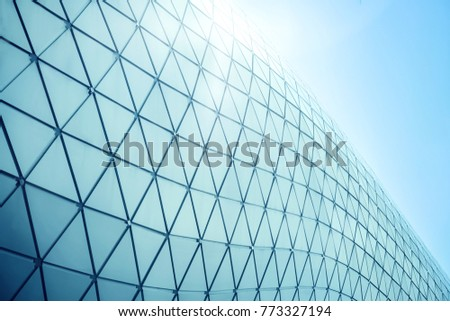 Building structures aluminum triangle geometry on facade of modern urban architecture #773327194