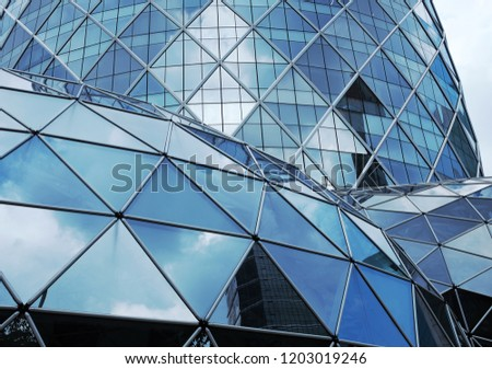 Building structures aluminum triangle geometry on facade of modern urban architecture. blur futuristic structures