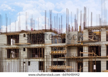 Building that is being built, concrete and sticking fittings #669648442