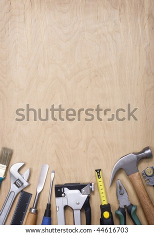 Building tool on a wooden background