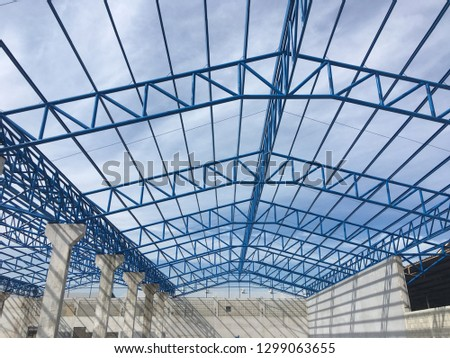 Building truss structure wherehouse  is under construction #1299063655