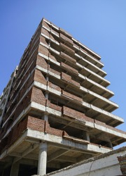 Building under construction against blue sky. General view of the construction of a new residential complex. Partially constructed Multi-storey buildings and high-rises. WER
