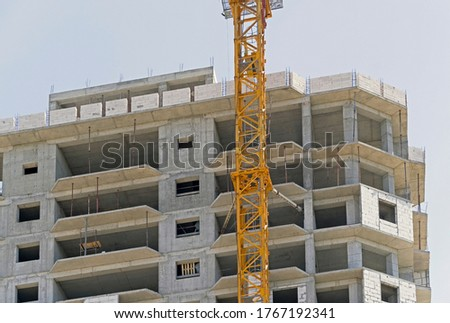 Photo of building under construction against the blue sky