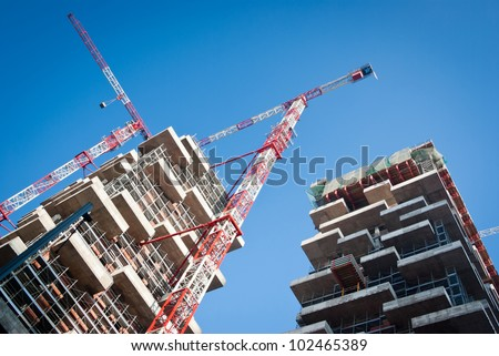 building under construction in a new residential area of Milan