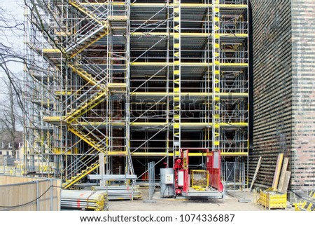 Building under construction  with scaffolds #1074336887