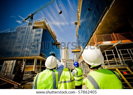 building under construction with workers stock photo
