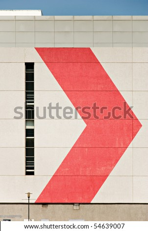 Building Wall with Red Arrow