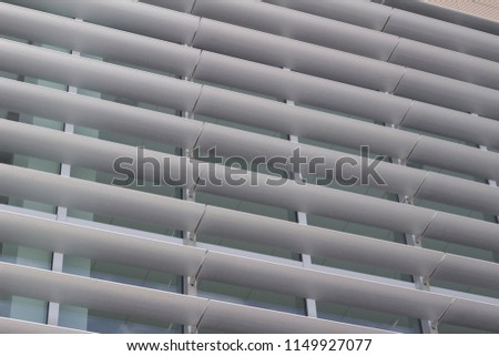Building windows designed with with attractive energy efficient shading louvers #1149927077