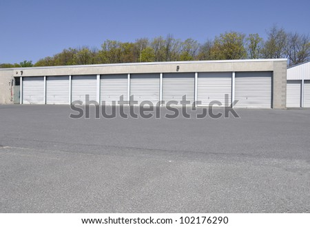 building with many garage doors, which are all closed;