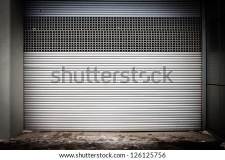 Building with metal roller shutter door