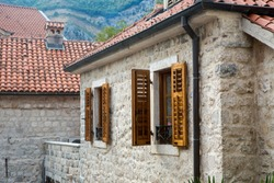 building with orange clay tiles and the windows open in Kotor Montenegro
