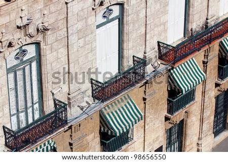Building With Sun Shields in Havana - stock photo