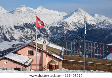 Building with swiss flag on the alpine skiing resort. St-Moritz, Switzerland