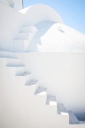 Building with white stairway, blue sky in background, Santorini, Greece