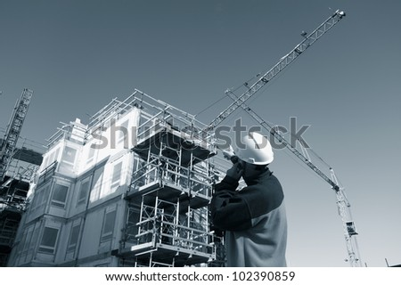 building worker and construction, blue toning idea